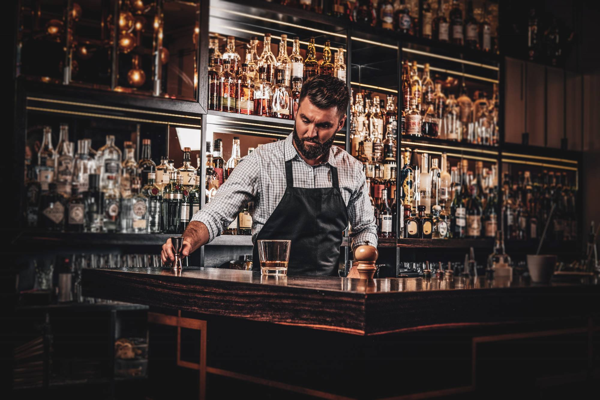 attractive barmen is prepairing drinks SJ8AHVA